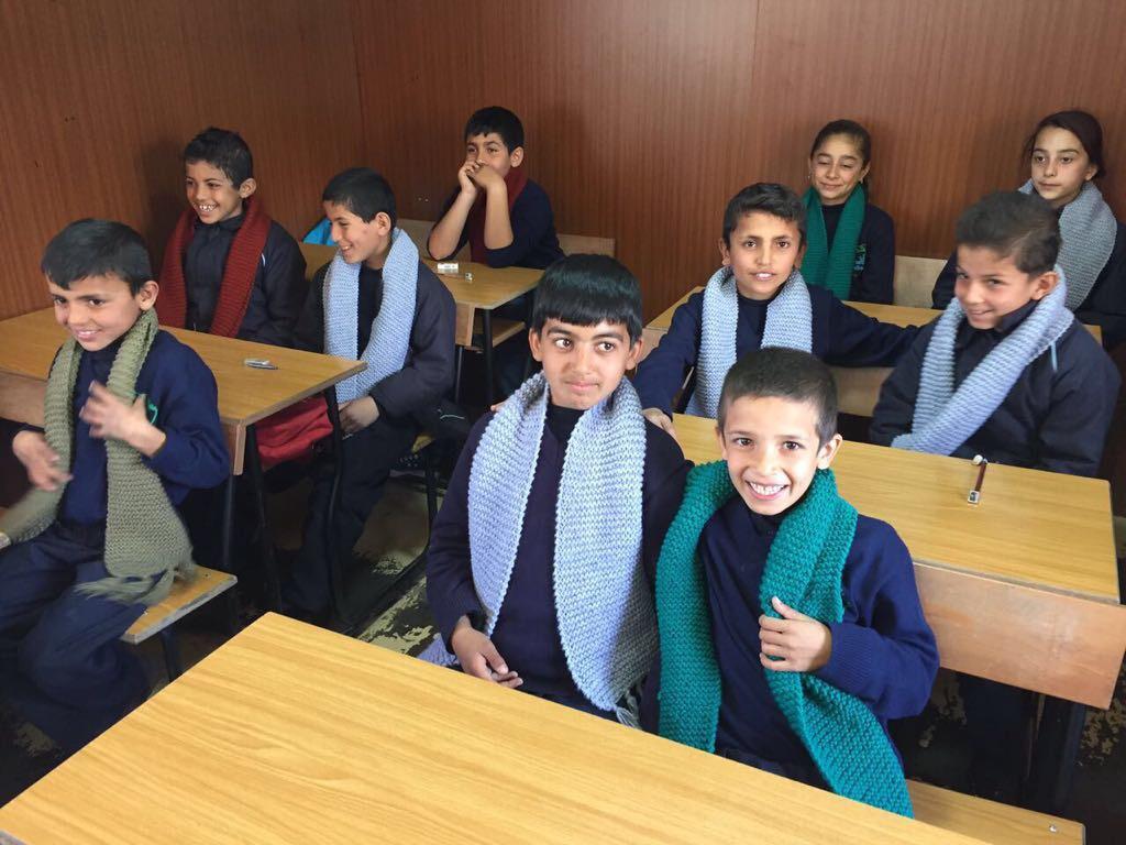 Syrian Refugee Children receiving LoveME scarves at refugee schools