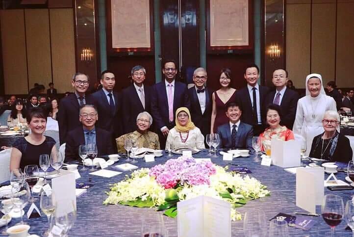 Tan Poh Kiang HCA 200k Dr Tan Poh Kiang (first row, third from right) seated next to Halimah Yacob at HCA's 30th Anniversary dinner.