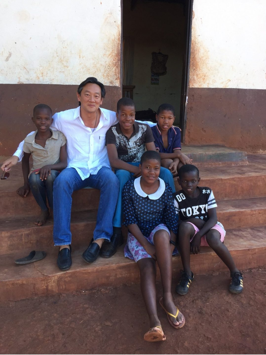 Timothy with the local children in Swaziland during one of the Desert Odyssey journeys. Photo taken from Desert Odyssey's Facebook page.