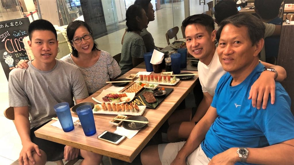 Caption: Reverend Keith Lai (right), with (left to right) his older son Caleb, wife Mui Fong and younger son Josiah, has a burden for fathers and started a mentoring programme in his church for these men. Photo courtesy of Reverend Keith Lai.