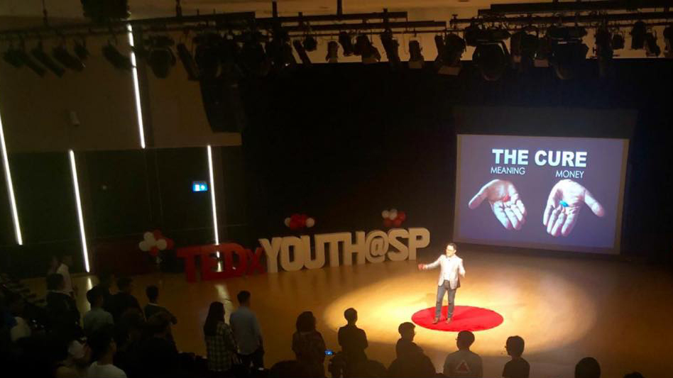 Eugene giving a TEDx talk at Singapore Polytechnic.