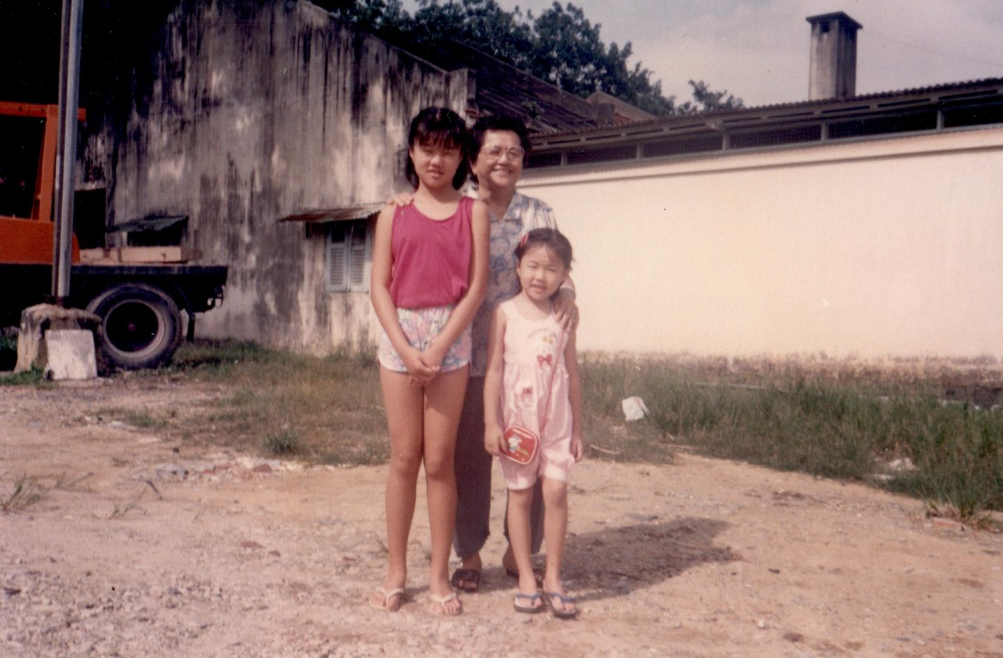 Arielle, 5, with her grandma and elder sister near their house in Changi.