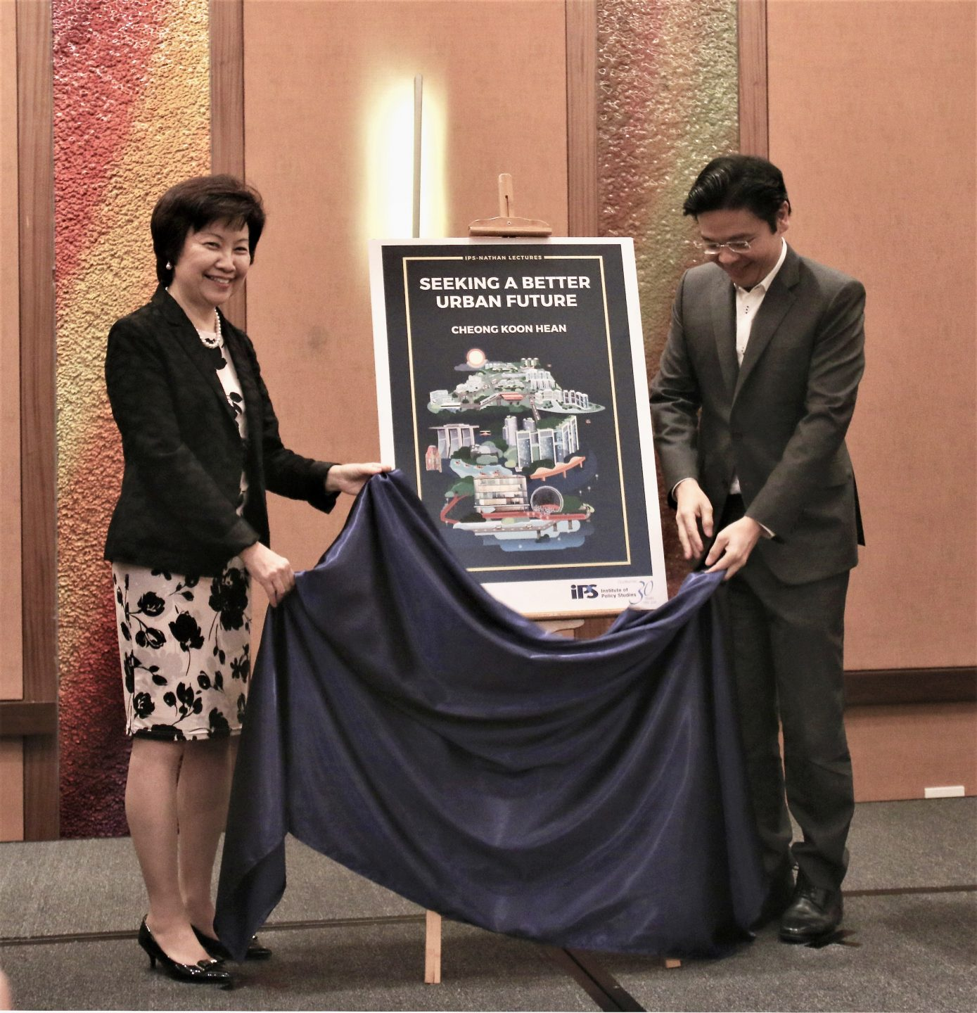 With Minister of National Development Lawrence Wong, the guest of honour at Dr Cheong's book launch in December 2018. Dr Cheong was the Institute of Policy Studies' 2018 SR Nathan Fellow, and delivered three lectures on Seeking A Better Urban Future. The lectures were consolidated into a book.