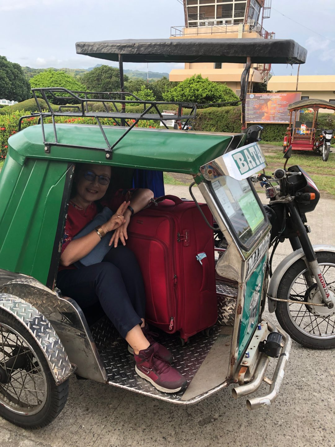 Yvonne in a tricycle in the  Philippines.